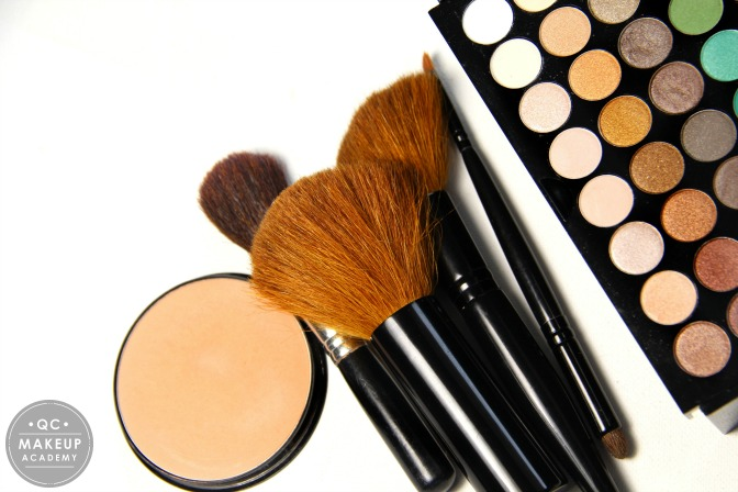 makeup artistry set laid flat on table