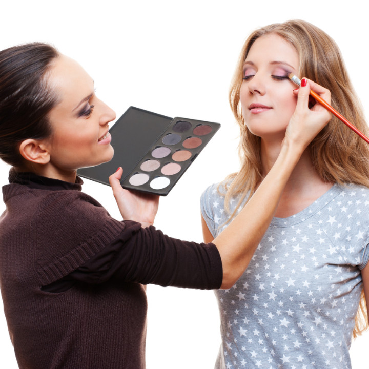 professional makeup artist with client