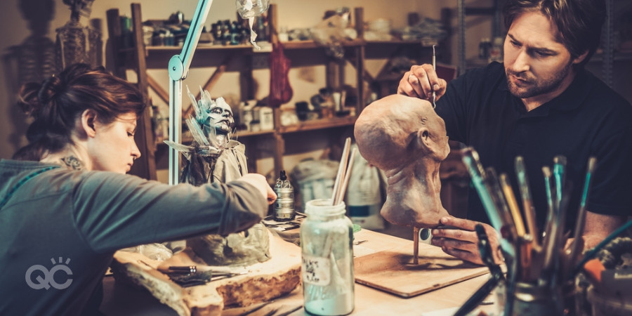 special effects makeup artists working on prosthetic head