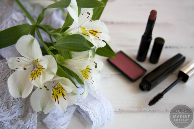 natural makeup on table with flowers