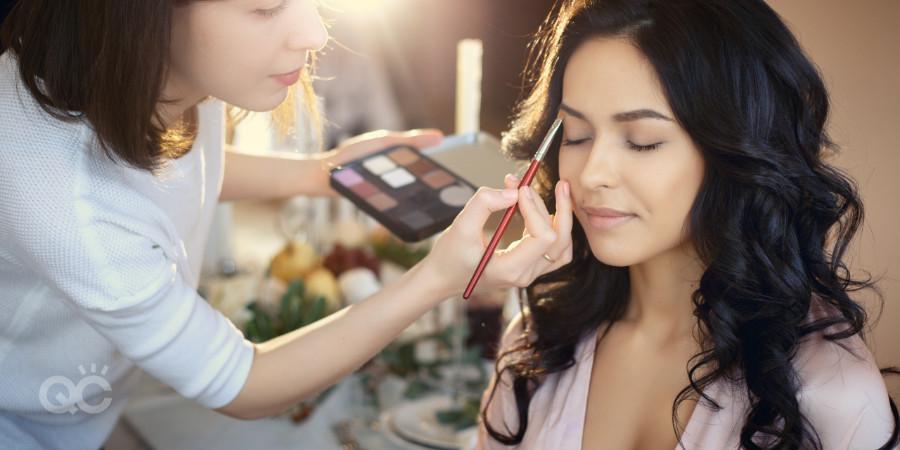 makeup artist working on client