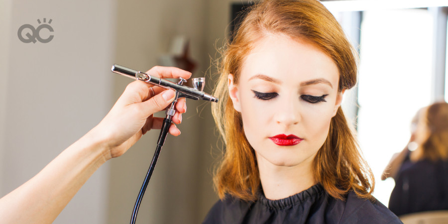 Applying airbrush makeup on a model