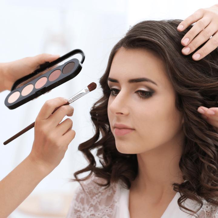 makeup artist certification holder working on model