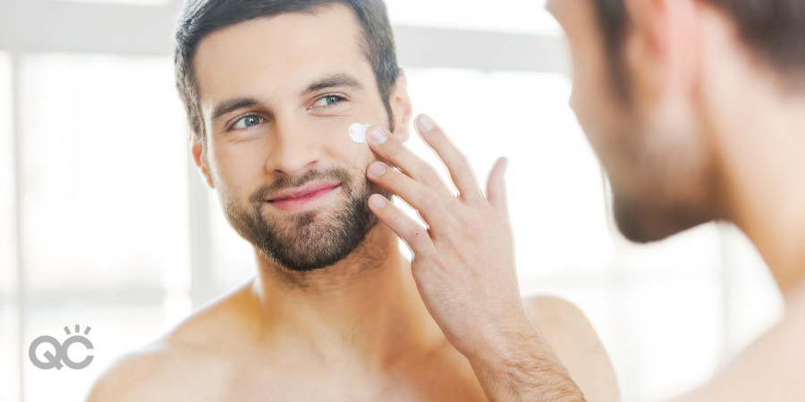 man using moisturizer after cleansing his face