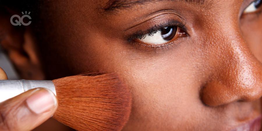 applying foundation on dark skin