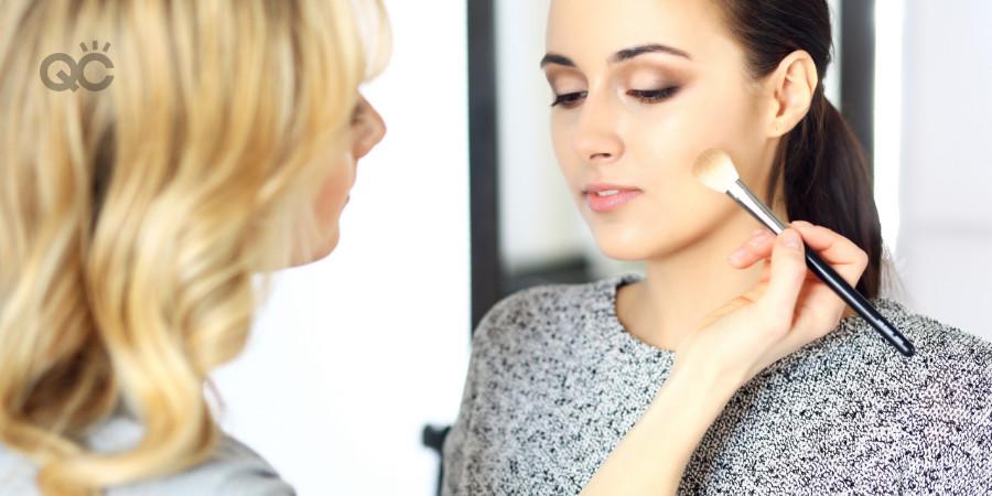 certified makeup artist applying contour on her makeup model