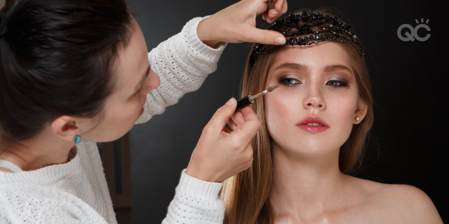 makeup student working on a fashion model's makeup