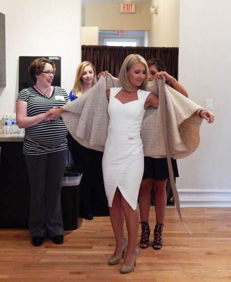 Mallory Sills being styled by her fellow professionals