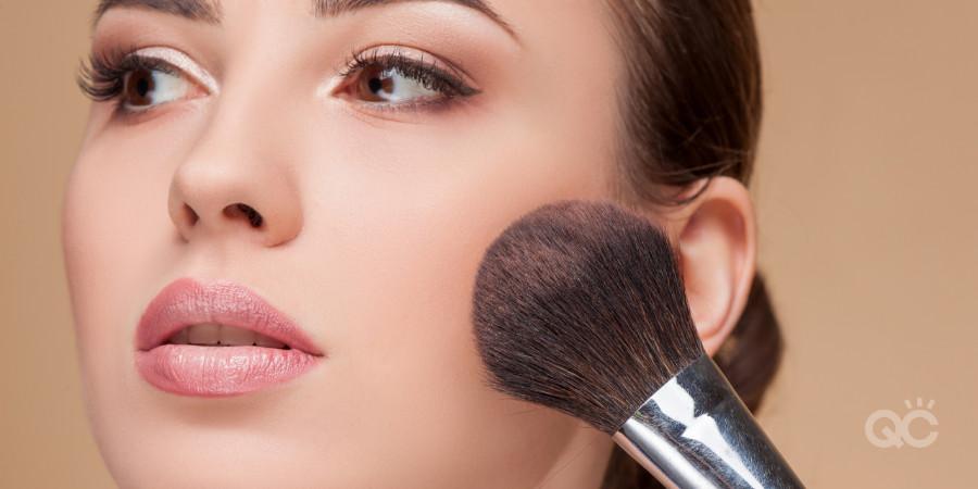 professional makeup artist applying blush to cheek