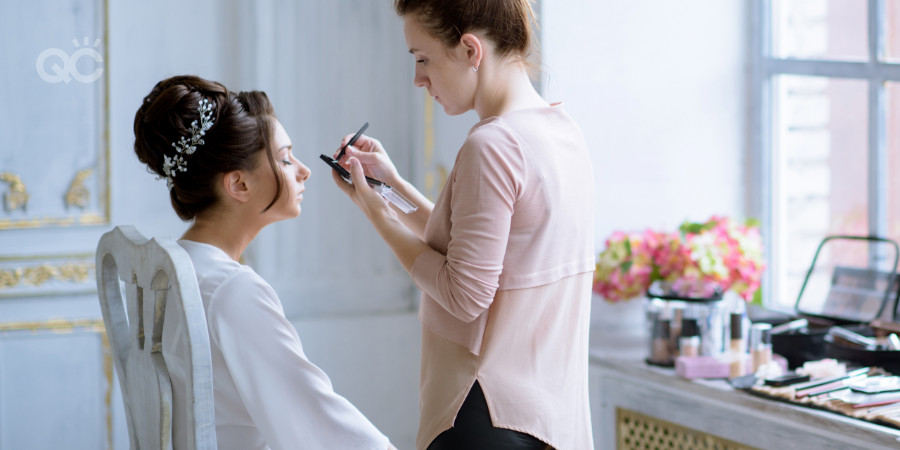 certified makeup artist working on a client for a wedding