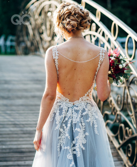Fashion styling a bride with a makeup artist according to her vision and color palette for event