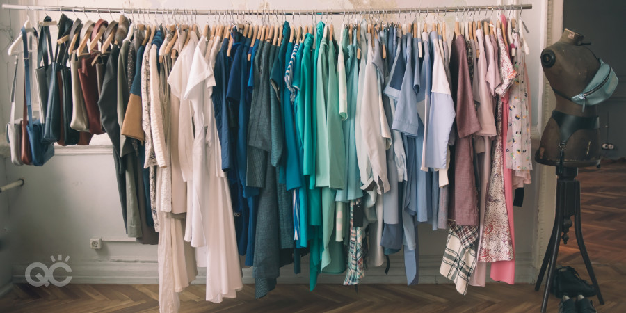 full closet organized by color and category