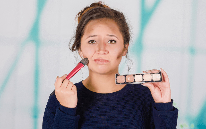 confused girl incorrectly applying contour