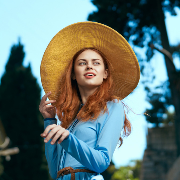 fashion styling course leads to successful fashion career - red head girl blue dress sun hat on