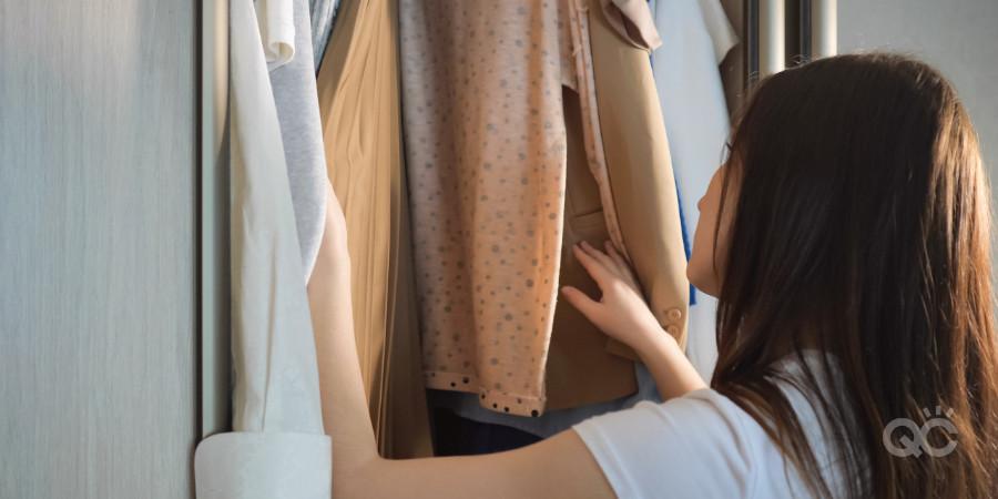 fashion stylist analyzing a wardrobe