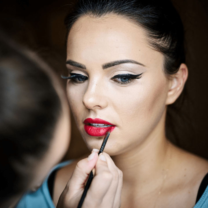 professional makeup artist applies makeup on model for online makeup class