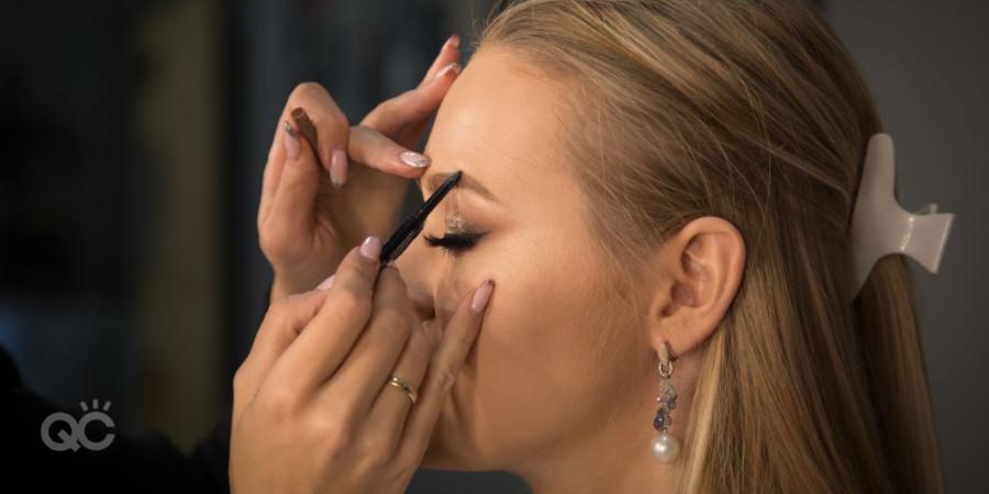 makeup artist applying brow makeup