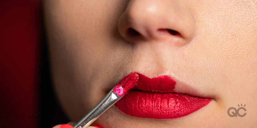 applying lipstick makeup