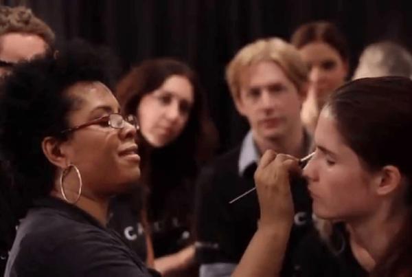 DeShawn Hatcher doing makeup on female model