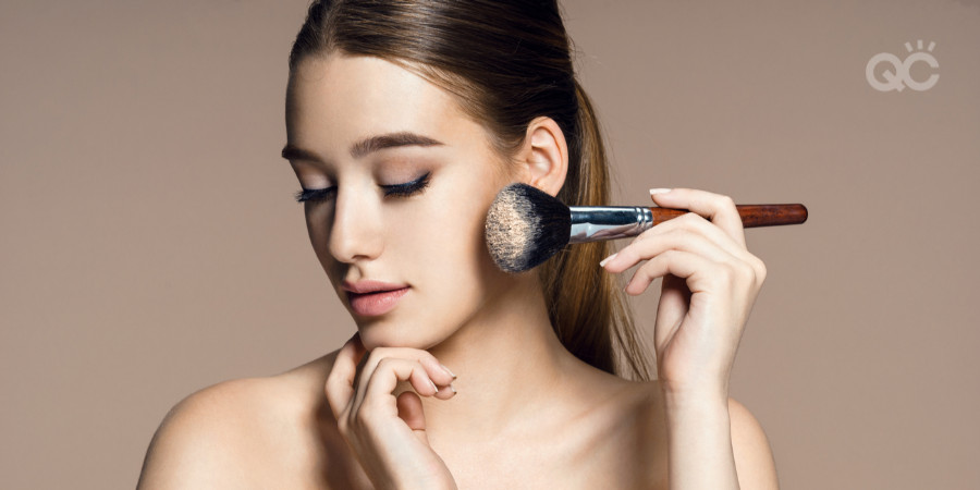 makeup items you don't need - girl putting on powder with brush