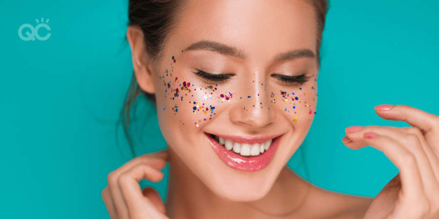 smiling girl with glitter on her cheeks