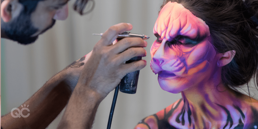 special fx makeup - man airbrushing animal look on client's face