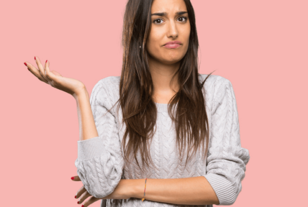 frustrated woman shrugging one arm, unsure what she's supposed to do