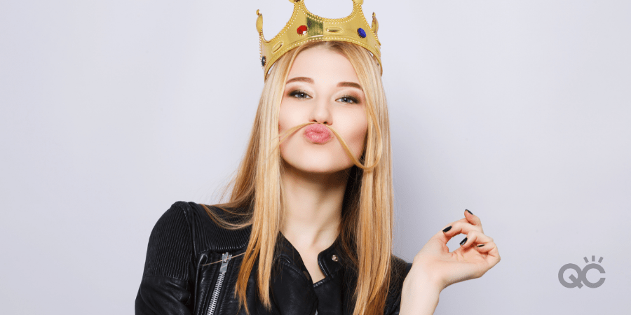 blonde girl with leather coat wearing crown on head