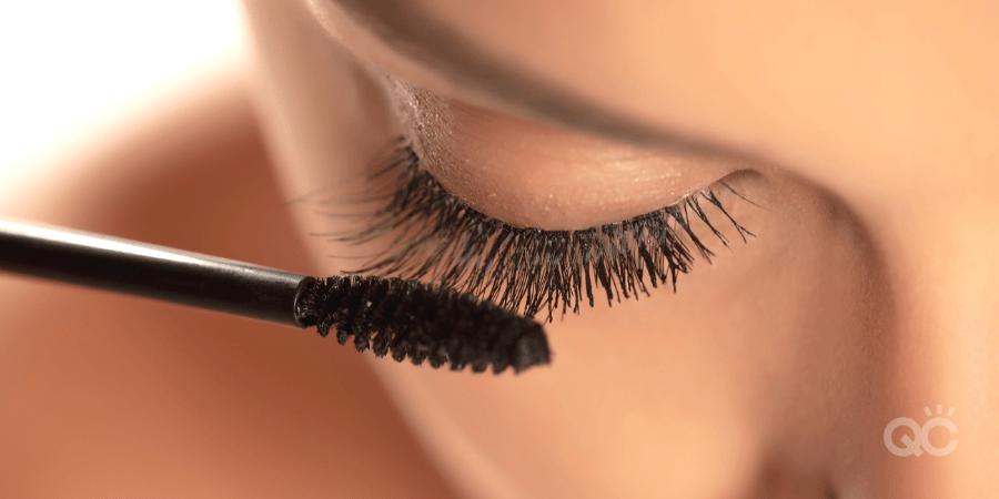 upclose of long lashes and mascara wand