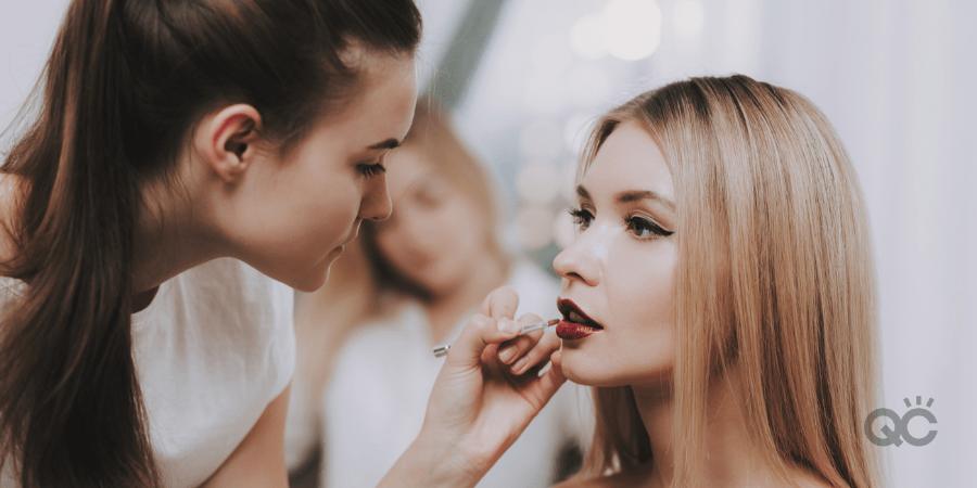 brunette mua doing blonde model's makeup