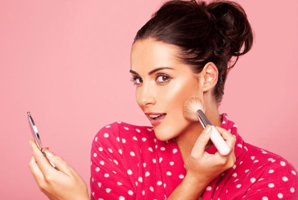 pink theme - girl applying blush