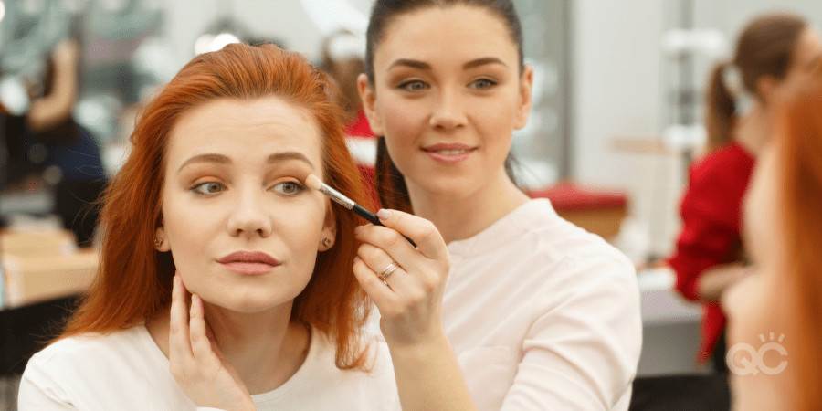 MUA showing client her eye makeup