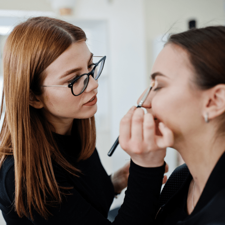 female mua working on client