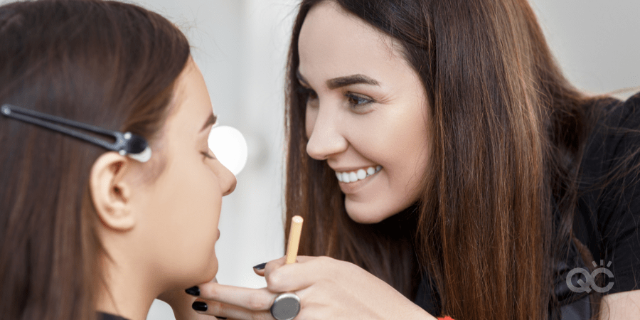 happy MUA doing makeup for young girl