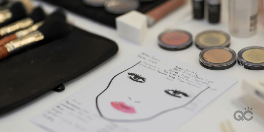 Makeup trial notes on paper with brushes and color powder professional makeup class