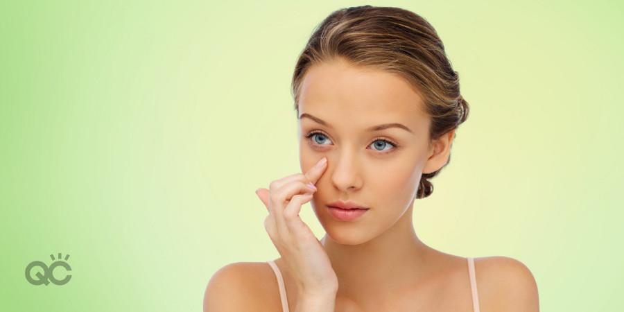 organic skincare model applying cream to her face