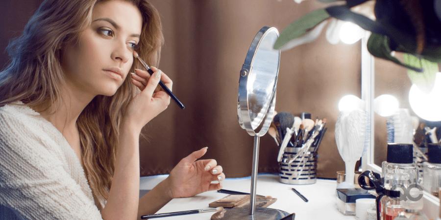 4 Ways to Keep Up Makeup Practice At Home Blog - Woman Applying Makeup in Mirror