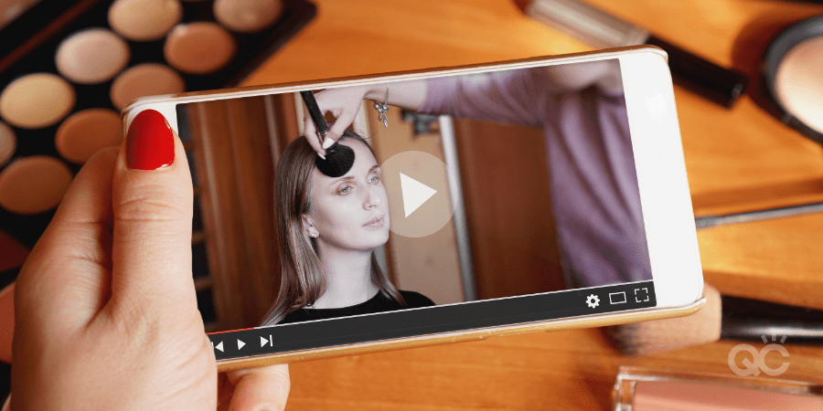 Mobile video of professional makeup artist applying makeup on model