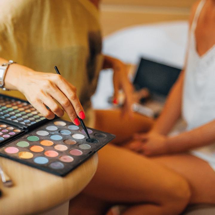 makeup artist training on model