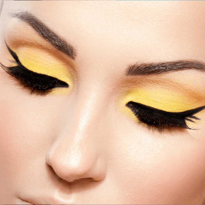 makeup career - yellow and orange eyeshadow with cat eye liner