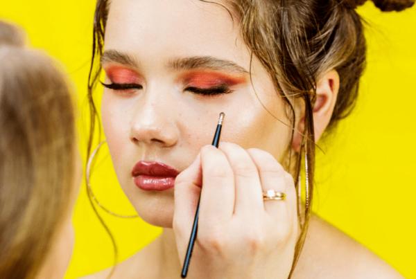makeup artistry professional putting makeup on model