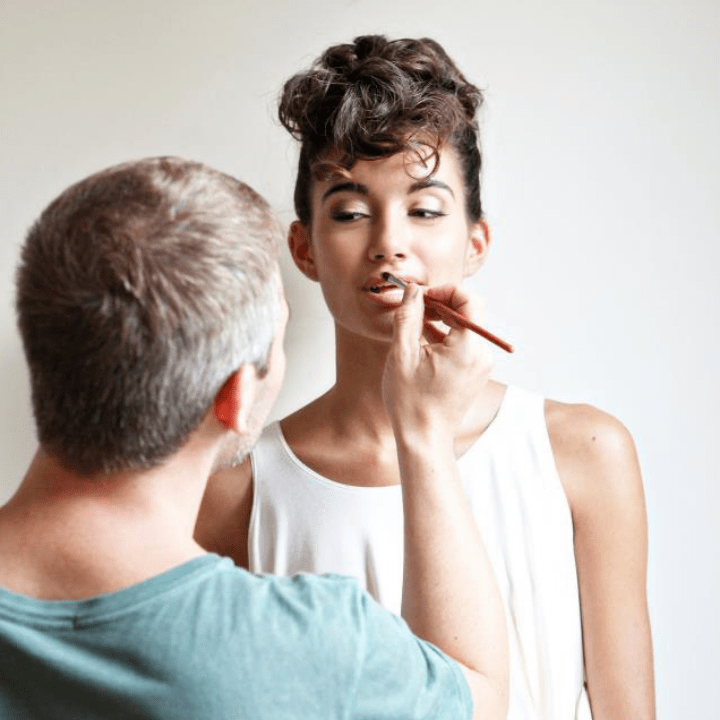QC makeup classes instructor, Nathan Johnson, doing makeup on female model