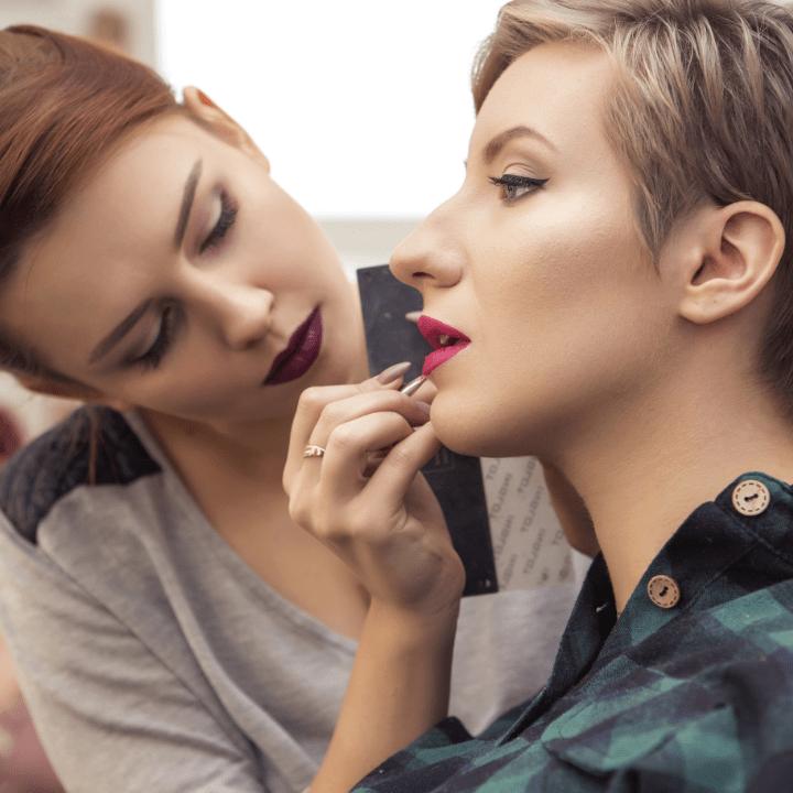 makeup artist doing makeup on female client