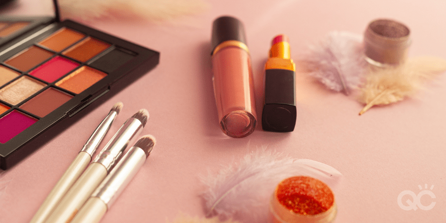 makeup products on pink surface
