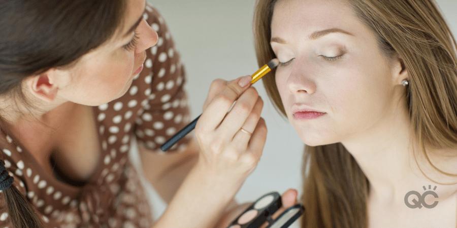 makeup artist doing makeup on client