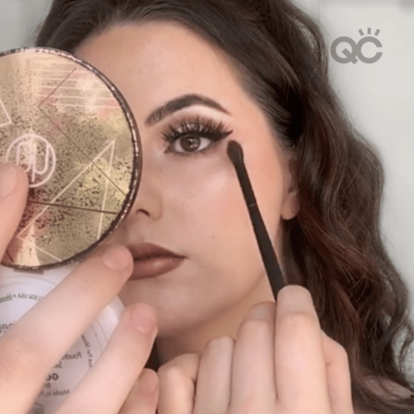 makeup classes graduate, Elly Nunns, doing makeup on herself