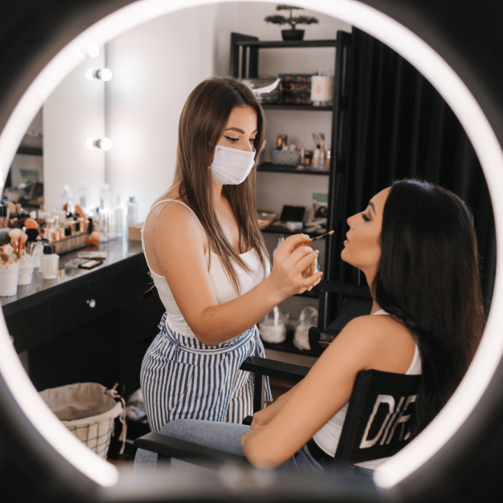 makeup jobs MUA working with client while wearing mask