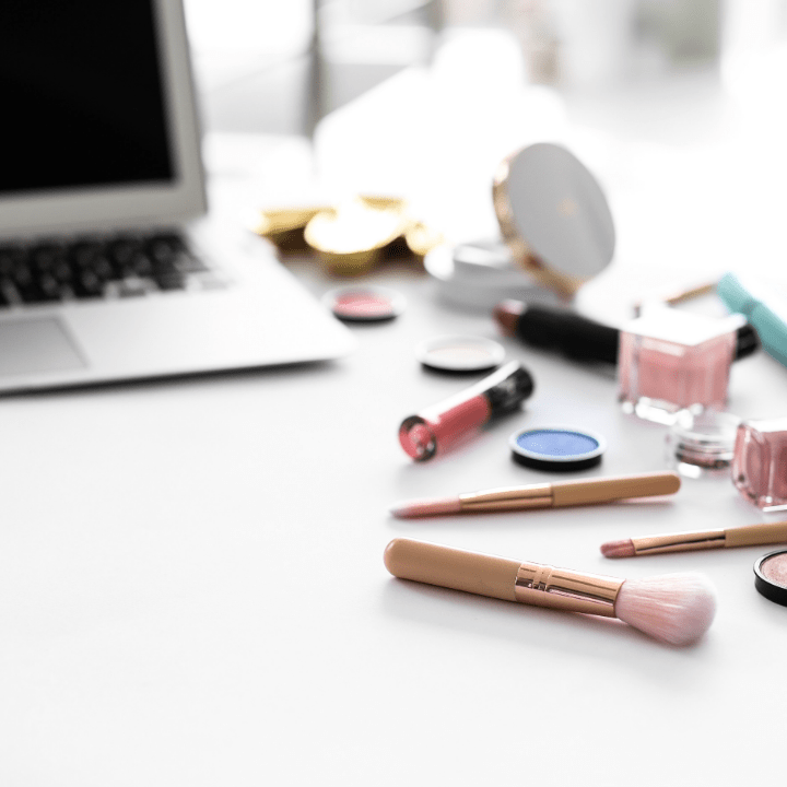 makeup products and laptop for online makeup schools