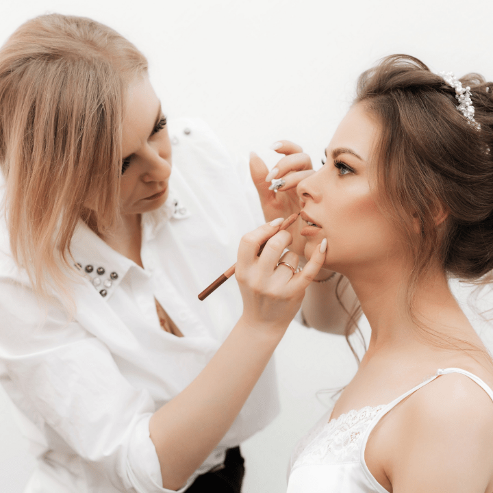 how to become a makeup artist, MUA doing makeup on bridal client