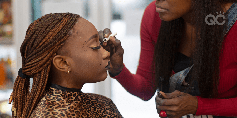 client having makeup done by professional makeup artist